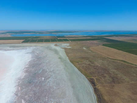 Saline Salt Lake in the Azov Sea coast. Former estuary. View from above. Dry lake. View of the salt lake with a birds eye view. Stock Photo