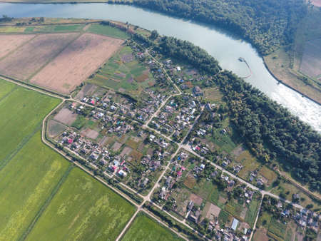 mid distance: Top view of the small village. Aerophotographing above the village. Stock Photo