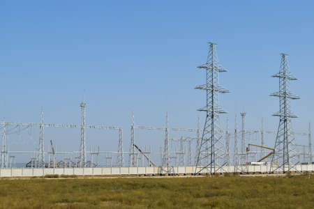 voltage gray: Power line support, insulators and wires. Appearance of a design. Assembly and installation of new support and wires of a power line. Stock Photo