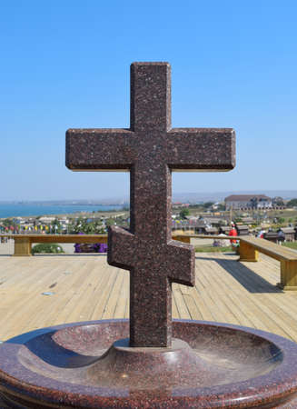 socle: Orthodox cross made of granite near the chapel.