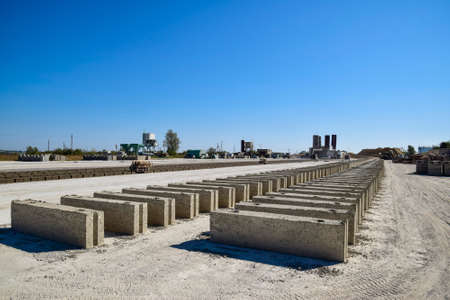 aerated: Cinder blocks lie on the ground and dried. on cinder block production plant Stock Photo