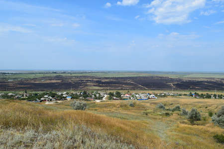 kuban: Blasted fields outside the village. The fact that left a fire on the field. the village from the hill view.