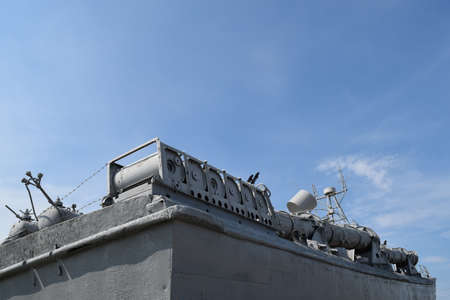 Part of the deck of a warship. communication devices and deck guns