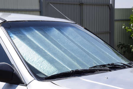 Sun Reflector windscreen. Protection of the car panel from direct sunlight Stock Photo