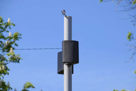 assignation: The loudspeaker on the pole. Outdoor speakers for fun walking in the park.