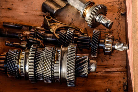 disassemble: Dismantled box car transmissions. The gears on the shaft of a mechanical transmission. Stock Photo