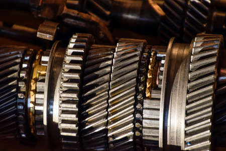 Dismantled box car transmissions. The gears on the shaft of a mechanical transmission. Stock Photo