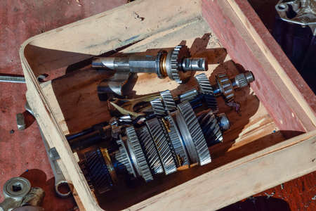 dismantled: Dismantled box car transmissions. The gears on the shaft of a mechanical transmission. Stock Photo