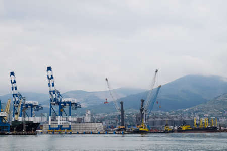 Novorossiysk, Russia - May 28, 2016: The international sea port of Novorossiysk. Port cranes and industrial objects. Marine Station.