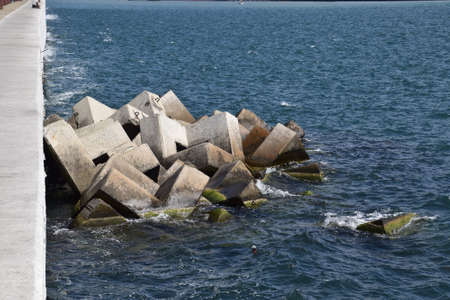end of a long day: Breakwater blocks in the port. Breakwater of the rectangular stone figures.