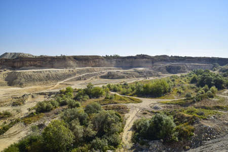 mine site: Large quarry for gravel mining, sand and clay. Mining machines and units. Mining.