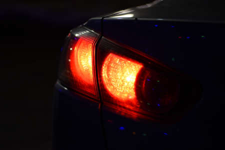 Discounted rear car lights in the dark. Stop signals.