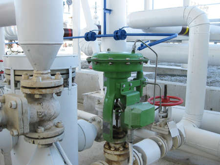 viscosity: Green pneumatic valve on the pipeline. The equipment of the oil plant.