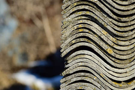 Folded neatly in a pile of old slate. Background of slate. Old building debris.
