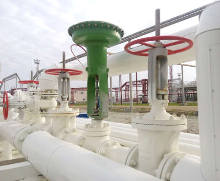 ben oil: Green pneumatic valve on the pipeline. The equipment of the oil plant.