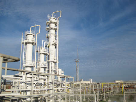 synthesis: The oil refinery. Equipment for primary oil refining.                             Stock Photo