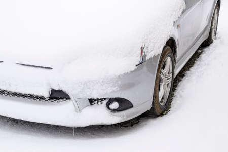 Fall asleep wet snow car. Snowfall of wet snow. Snow lying on the car.