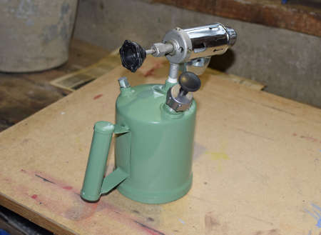 butane: Blowtorch, general view. Blowtorch with a green tank Stock Photo