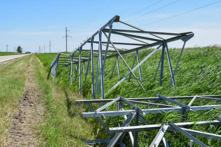 Power line support, insulators and wires. Appearance of a design. Assembly and installation of new support and wires of a power line. Stock Photo