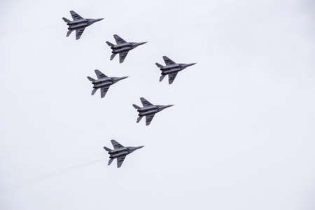 aerobatic: Krasnodar, Russia - February 23, 2017: Air show in the sky above the Krasnodar airport flight school. Airshow in honor of Defender of the Fatherland. MiG-29 in the sky.