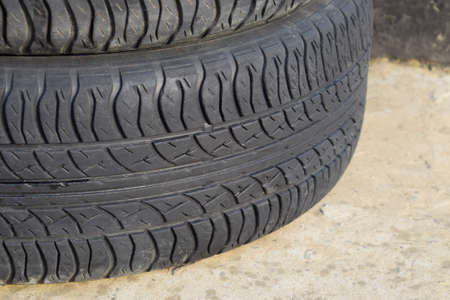 traction: Automobile wheel. Rubber tires. Summer rubber set for the car. Wheel tread pattern. Stock Photo