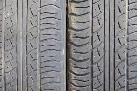 dirty car: The background of the tread pattern of the car wheel. Rubber tires. Stock Photo