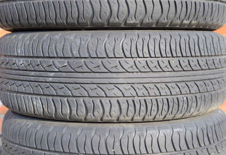 winter tires: The background of the tread pattern of the car wheel. Rubber tires. Stock Photo
