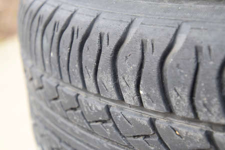 dirty car: Automobile wheel. Rubber tires. Summer rubber set for the car. Wheel tread pattern. Stock Photo