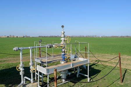 throttle: Oil well. The equipment and technologies on oil fields. Stock Photo