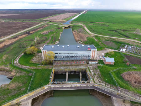 Water pumping station of irrigation system of rice fields. View from above. Stock Photo
