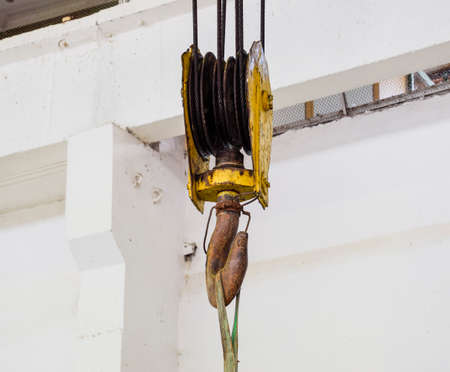 mechanization: Hoist with winch and hook. A tool for moving goods in a production room. Mechanization of labor.