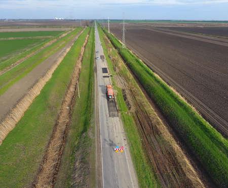 blacktop: Top view of the road repair. Technics for repair of asphalt. Replacement of asphalt pavement