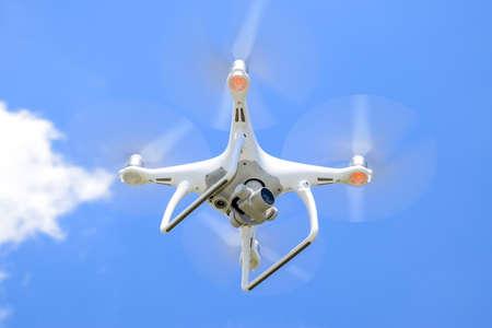 Krasnodar, Russia - May 30, 2017: Drone DJI Phantom 4 in flight. Quadrocopter against the blue sky with white clouds. The flight of the copter in the sky. Editorial