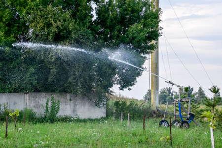 radius: Irrigation system Watering in the garden. Watering the seedlings in the park. Watering the fields. Sprinkler