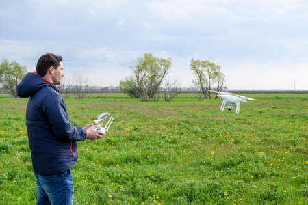 A man with a remote control in his hands. Flight control of the drone. Phantom.