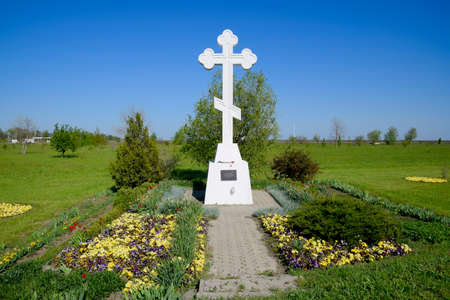 Orthodox cross on the entrance to the settlement. Symbol of the Christian faith. Orthodox cross for absorption entering into the city. Stock Photo