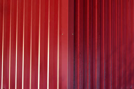 Diagonal pattern of metal profile. Fences from the galvanized iron painted by a polymeric covering.