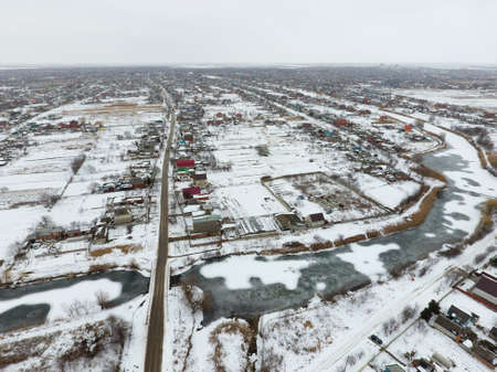 reviews: Winter view from the birds eye view of the village. The streets are covered with snow.