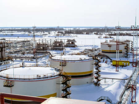 Russia, Nefteyugansk - January 24, 2016: A view of oil field equipment. Tanks with oil owned oil company Rosneft. Standard-Bild