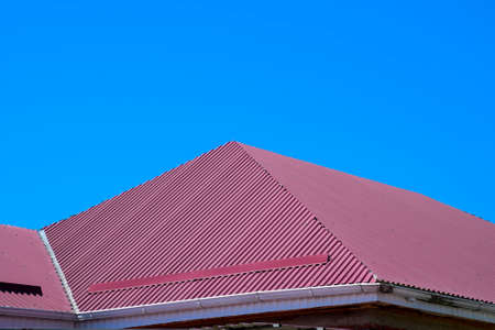 gable home renovation: The roof of corrugated sheet. Roofing of metal profile wavy shape.