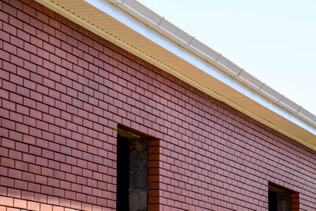 New brick house under construction. Brown and pink brick
