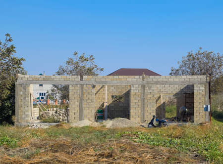 realestate: Unfinished house from a cinder block. The walls of the building under construction