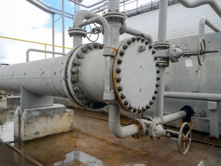 Heat exchangers for heating of oil . Oil refinery. Equipment for primary oil refining. Stock Photo