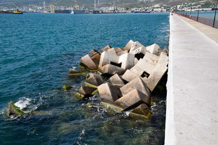 Breakwater blocks in the port. Breakwater of the rectangular stone figures.