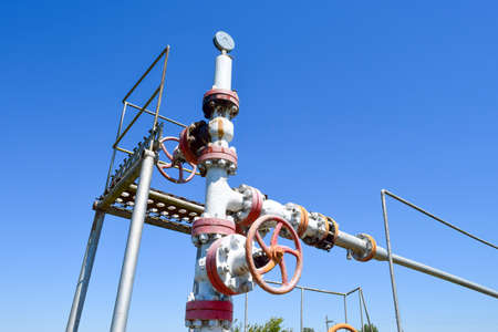 Oil well wellhead equipment. Hand valve with handwheel for opening and closing the flow line