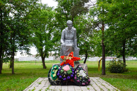 Monument to the Mother of a Soldier waiting for her son from the war. Sculpture of an unknown author in the park