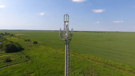 Cellular tower. Equipment for relaying cellular and mobile signal. Fly around up and down. Stock Photo
