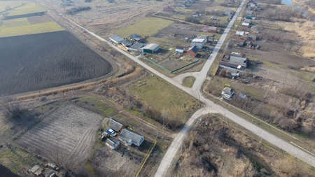 View from the top of the village. Streets without asphalt and single-storey houses. The Kuban village