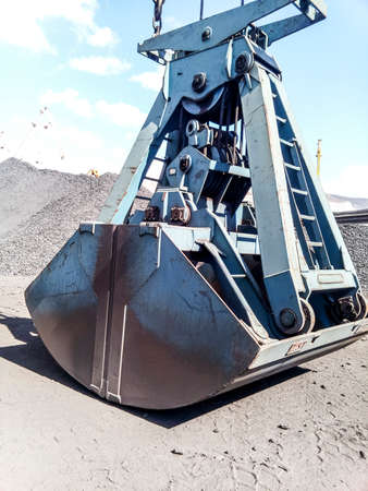 Clamshell bucket in the cargo port. Bucket for loading coal.
