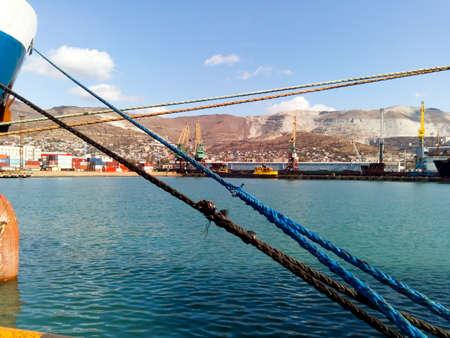 Tightened mooring ropes. Mooring of the ship.